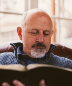 Pastor reading the Bible - SermonCentral user